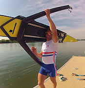 Caversham, Great Britain, Jonny WALTON carries his boat after the Morning training session. Go Pro on Time lapse, on the boating dock at the GB Rowing media day at the Redgrave Pinsent Rowing Lake. GB Rowing Training centre.  Thursday  19/05/2011 [Mandatory Credit. Peter Spurrier/Intersport Images]