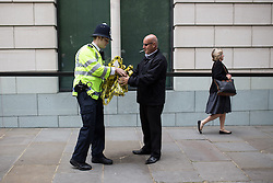"© Licensed to London News Pictures . 12/06/2013 . London , UK . Police and security tidy up after the demonstration . A demonstration organised by a coalition of anti-militarist groups , including Sussex Stop G8 , Smash EDO and Disarm DSEI , at BAE Systems office on Carlton Gardens , London , today (Wednesday 12th June) . This as part of a series of "" Stop G8 "" anti capitalist protests in London this week ahead of Britain hosting the 39th G8 summit on 17th/18th June at the Lough Erne Resort , County Fermanagh , Northern Ireland , next week .  Photo credit : Joel Goodman/LNP"