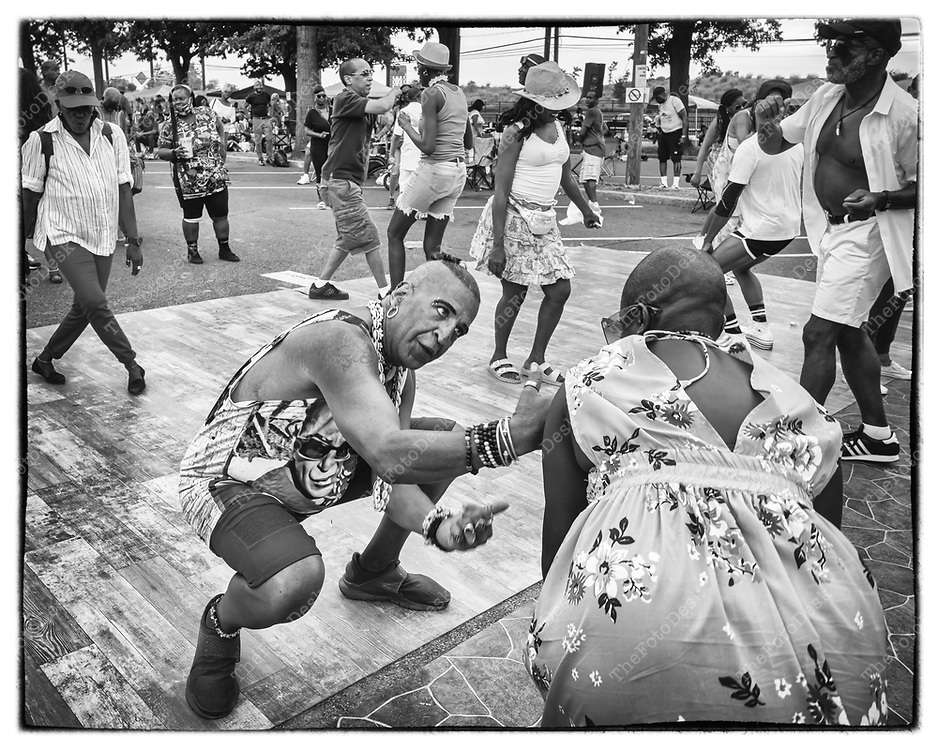 JERSEY CITY, NEW JERSEY:  Henry Garrison, 60  AKA John John, dances with a friend during the Jersey City House Music Festival at Lincoln Park, in Jersey City, NJ.  Many came to support John John to celebrate his birthday.  (Brian Branch-Price/TheFotodesk).