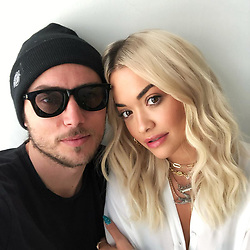 "Rita Ora releases a photo on Twitter with the following caption: """"Love working with this cat always a pleasure 🕶📸"""". Photo Credit: Twitter *** No USA Distribution *** For Editorial Use Only *** Not to be Published in Books or Photo Books ***  Please note: Fees charged by the agency are for the agency's services only, and do not, nor are they intended to, convey to the user any ownership of Copyright or License in the material. The agency does not claim any ownership including but not limited to Copyright or License in the attached material. By publishing this material you expressly agree to indemnify and to hold the agency and its directors, shareholders and employees harmless from any loss, claims, damages, demands, expenses (including legal fees), or any causes of action or allegation against the agency arising out of or connected in any way with publication of the material."