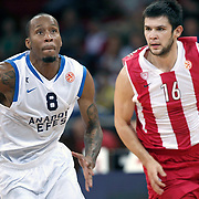 Anadolu Efes's Terence KINSEY (L) and Olympiacos's Konstantinos PAPANIKOLAOU (R) during their Two Nations Cup basketball match Anadolu Efes between Olympiacos at Abdi Ipekci Arena in Istanbul Turkey on Sunday 02 October 2011. Photo by TURKPIX