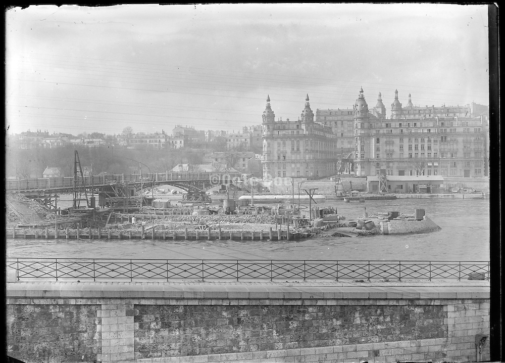 building of island in the Seine by the old Pont Passy Paris before 1900 France looking from the Left to the Right bank of the Seine