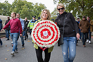 Bristol City fans and their wreath during the Football Lads Alliance march between Park Lane and Westminster Bridge, London on 7 October 2017. Photo by Phil Duncan.