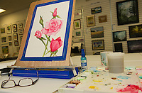 A floral piece by artist Shirley Fitzgerald at the Lakes Region Art Association's gallery space in the Tanger Outlet Mall.  (Karen Bobotas/for the Laconia Daily Sun)