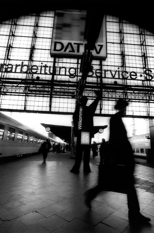 Passengers walk from departing trains in the Haupbanhof, Frankfurt, Germanys' main central train station.