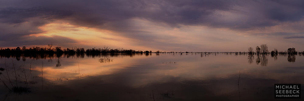 Reflections of a hazy sunset on Lake Menindee. <br /> <br /> Captured when the Lake Menindee system and Darling River used to contain water....<br /> <br /> Code: HANL0001<br /> <br /> Limited Edition Print