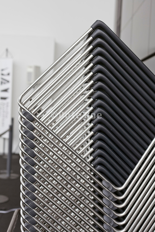 neatly designed stacked chairs