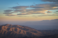 These little lenticular clouds repeatedly formed over the same area as seen from Keys View. Lenticular clouds form when strong winds encounter a mountain range. The air is forced upward where it condenses into a cloud. These strange disc-shaped clouds form often in the California desert.<br /> <br /> Date Taken: August 19, 2014
