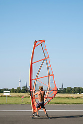 Land surfing at former Tempelhof Airport now public city park in Berlin , Germany