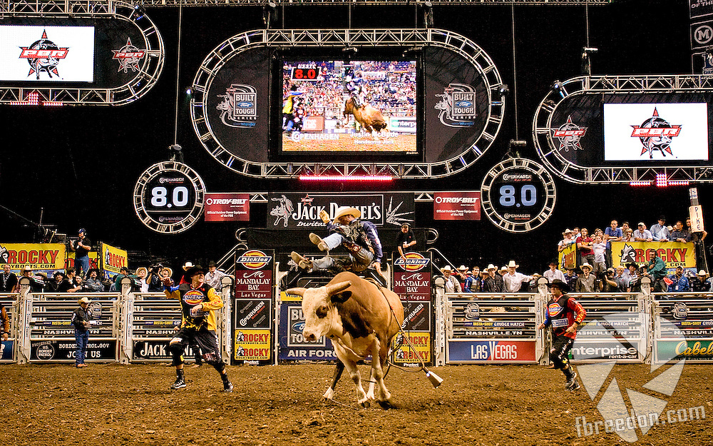 Justin McBrides rides Handsome Jack at the Professional Bullriders Tour at the Sommet Center in Nashville, Tennessee on Friday, August 29, 2008. (Photo by Frederick Breedon)