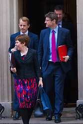 London, March 24th 2015. Members of the Cabinet gather at Downing street for their weekly meeting. PICTURED: Baroness Stowell, Jeremy Wright QC and David Laws