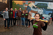 Depave's core volunteers with a mural of a farmer plowing up concrete to reclaim the land. Volunteers working with the Portland Oregon nonprofit group Depave remove asphalt and concrete from parking lots in order to create gardens and playgrounds that foster both a higher quality of life and also better stormwater drainage, averting polluted, toxic runoff from streams and rivers. ** See accompanying text story within picture package.