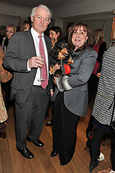 CHARLES & CAROLINE GREGSON and their dog Brillo at the launch of George's Dinner for Dogs menu in aid of The Dog's Trust held at George, 87-88 Mount Street, London on 19th March 2013.