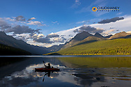 Kayaker with fishing gear in Glacier National Park, Montana, USA