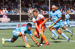 (L-R) Birenda Lakra of India, Jeroen Hertzberger of The Netherlands during the Champions Trophy match between the Netherlands and India on the fields of BH&BC Breda on June 30, 2018 in Breda, the Netherlands