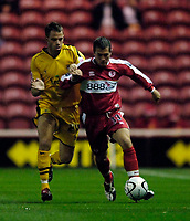 Photo: Jed Wee.<br /> Middlesbrough v Notts County. Carling Cup. 20/09/2006.<br /> <br /> Middlesbrough's Andrew Taylor (R) holds off Notts County's Ian Ross.