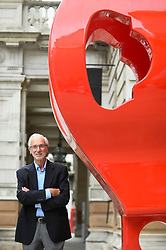 """© Licensed to London News Pictures. 12/09/2018. LONDON, UK. Internationally renowned architect and Honorary Royal Academician Renzo Piano at a preview of """"Renzo Piano: The Art of Making Buildings"""", an exhibition comprising 16 of his most significant projects.  He is seen next to a 'gerberette', a full sized copy of a die-cast rocker beam used in the Centre George Pompidou in Paris,   The exhibition runs 15 September to 20 January 2019 at the Royal Academy of Arts in Piccadilly.  Photo credit: Stephen Chung/LNP"""