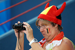 A Belgium fan takes a pic of the match