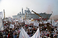 HMS Invincible makes a triumphant return to Portsmouth harbour after assisting in the victory in the Falklands conflict. The carrier was equipped with flagship facilities and provided an operational headquarters for Royal Navy task forces throughout the conflict. Photograph by Terry Fincher 1982.