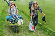 Arrivals face blistering heat as they struggle in with their kit. The 2015 Glastonbury Festival, Worthy Farm, Glastonbury.