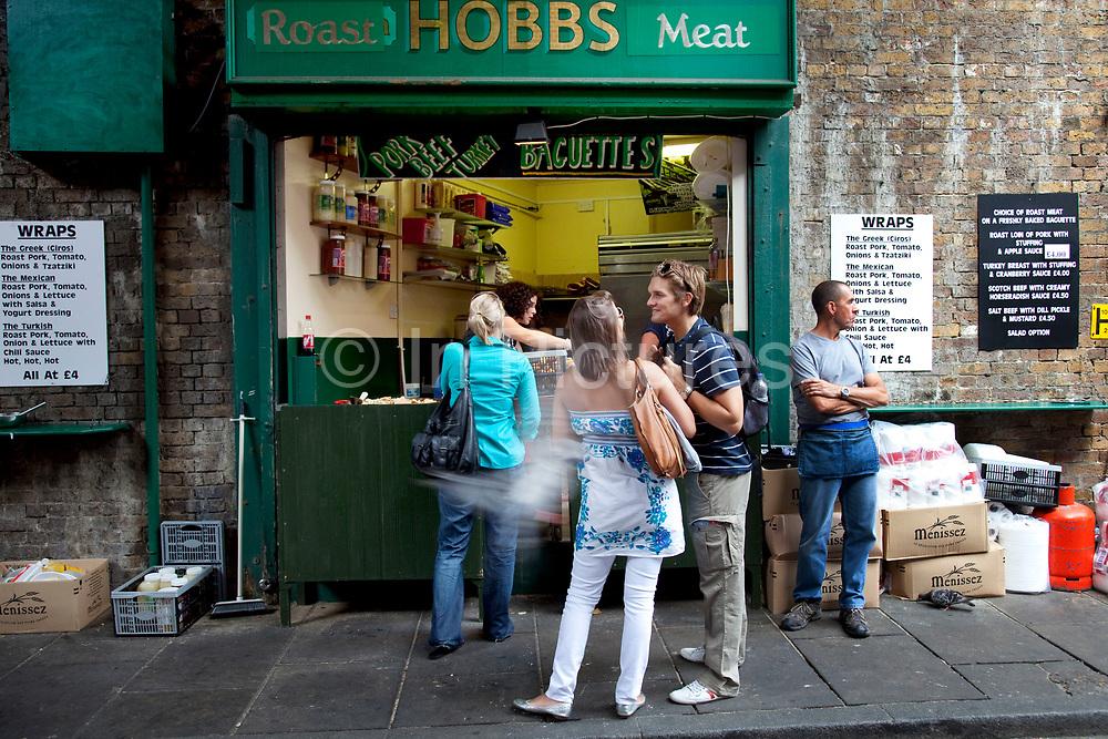 Roast pork baguette stall. Hobbs. Borough Market is a thriving Farmers market near London Bridge. Saturday is the busiest day.
