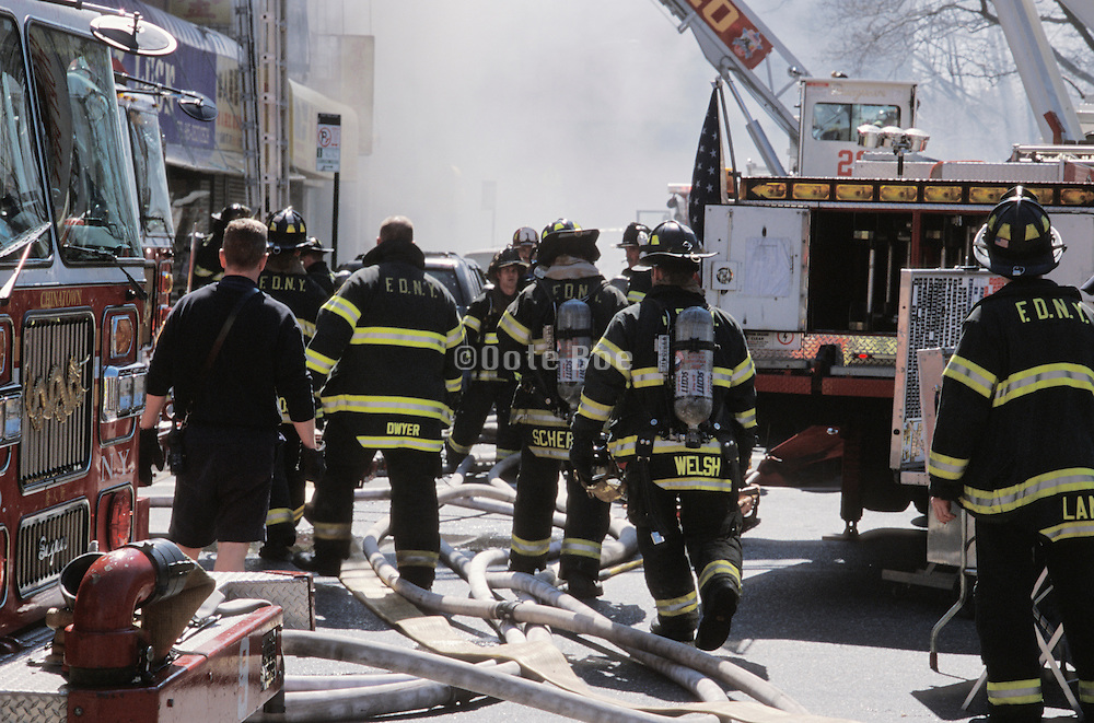 New York Fire Department working together to put out a fire