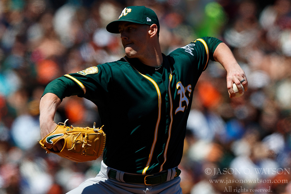 SAN FRANCISCO, CA - JULY 15: Ryan Buchter #52 of the Oakland Athletics pitches against the San Francisco Giants during the seventh inning at AT&T Park on July 15, 2018 in San Francisco, California. The Oakland Athletics defeated the San Francisco Giants 6-2. (Photo by Jason O. Watson/Getty Images) *** Local Caption *** Ryan Buchter
