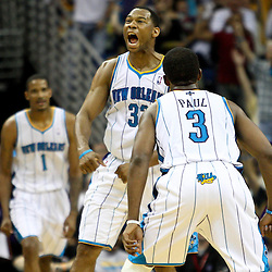 April 8, 2011; New Orleans, LA, USA; New Orleans Hornets shooting guard Willie Green (33) celebrates with point guard Chris Paul (3) after scoring during the fourth quarter against the Phoenix Suns at the New Orleans Arena. The Hornets defeated the Suns 109-97.   Mandatory Credit: Derick E. Hingle