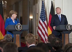 April 27, 2018 - Washington, District of Columbia, United States of America - United States President Donald J. Trump and Chancellor Angela Merkel of Germany conduct a joint press conference in the East Room of the White House in Washington, DC on Friday, April 27, 2018..Credit: Ron Sachs / CNP (Credit Image: © Ron Sachs/CNP via ZUMA Wire)