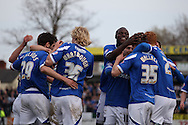Portsmouth players celebrate after Jed Wallace scores their side's second goal. Skybet football league two match, Newport county v Portsmouth at Rodney Parade in Newport, South Wales on Saturday 29th March 2014.<br /> pic by Mark Hawkins, Andrew Orchard sports photography.