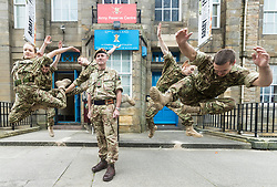 Brigadier Gary Deakin CBE welcomes performers to the Army reserve centre at Hepburn House for the opening of the Army's first ever Edinburgh Festival Fringe venue.<br /> <br /> Pictured: Performers from the Rosie Kay Dance Company production of 5 Soldiers with Brigadier Gary Deakin CBE recreating a scene in the play where they have been hit by an IED in Afghanistan