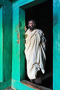 Priest at the inner entrance to Medhane Alem Adi Kesho Church, Adi Kesho, Tigray region. Ethiopia, Horn of Africa