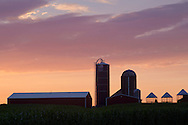 Town of Wallkill, New York - A barn and silos are seem against the dawn sky at Smiley Farm on July 29, 2014.