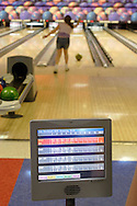 Chester, NY -  An 11-year-old girl bowls at an alley that features electronic scoring  on June 9, 2007.