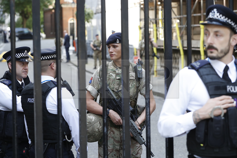 © Licensed to London News Pictures. 24/05/2017. London, UK. Soldiers are seen on duty in Downing Street. The terrorism threat level has been raised to critical and Operation Temperer has been deployed. 5,000 troops are taking over patrol duties under police command. Photo credit: Peter Macdiarmid/LNP