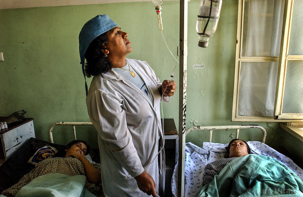 I nurse checks the IV drugs being administered to Afghan patients at the Rabia Balkhi hospital in Kabul, Afghanistan August 4, 2002. Infant mortality in Afghanistan in 2000 was 165 per 1,000. live births - one of the highest figures in the world, according to the United Nations International Children's Fund (UNICEF). More than one if four children die before age 5. The U.S. infant mortality rate is 7 per 1,000. Half Afghanistan's children suffer from malnutrition. (Photo  by Ami Vitale)