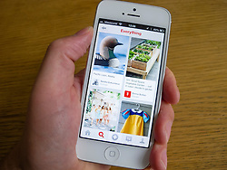 Pintrest social media and photo sharing app on  white iPhone 5 smartphone white iPhone 5 smartphone
