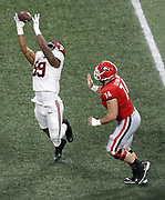 ATLANTA, GA - JANUARY 08:  Defensive end Raekwon Davis #99 of the Alabama Crimson Tide makes an interception near guard Ben Cleveland #74 of the Georgia Bulldogs during the College Football Playoff National Championship game at Mercedes-Benz Stadium on January 8, 2018 in Atlanta, Georgia.  (Photo by Mike Zarrilli/Getty Images)