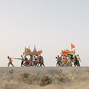 Some of the Hindu pilgrims walk for about 8 days in the blistering heat, from Karachi to the pilgrimage site (about 270 Km). They push a cart loaded with the deity from their local temple, bringing it to Nandi Mandir, the pilgrimage's main holy site. It is believed that accessing the pilgrimage on foot is more auspicious. The cart is loaded with a generator, playing loud Hindu music, and lights up at night. Pilgrims sleep out in the open or in small roadside hotels.