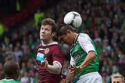 The William Hill Scottish FA Cup Final 2012 Hibernian Football Club v Heart Of Midlothian Football Club..19-05-12...Hearts Darren Barr wins the header from Hibs Jorge Claros        during the William Hill Scottish FA Cup Final 2012 between (SPL) Scottish Premier League clubs Hibernian FC and Heart Of Midlothian FC. It's the first all Edinburgh Final since 1986 which Hearts won 3-1. Hearts bid to win the trophy since their last victory in 2006, and Hibs aim to win the Scottish Cup for the first time since 1902....At The Scottish National Stadium, Hampden Park, Glasgow...Picture Mark Davison/ ProLens PhotoAgency/ PLPA.Saturday 19th May 2012.
