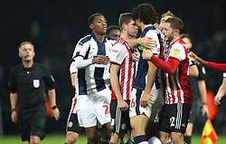 Brentford's Chris Mepham (centre) and West Bromwich Albion's Ahmed Hegazi confront each other during the Skybet Championship match at The Hawthorns, West Bromwich.