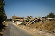 Asia, Syria, Golan. Damaged buildings along a road in the now deserted town of Quneitra, in the buffer zone between Syria and Israel.