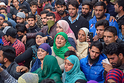 November 1, 2018 - Pulwama, Jammu & Kashmir, India - Kashmiri Muslims women are seen crying during funeral procession of slain militant Mohd Amin at his residence in Pampore..Thousands of people took part in the funeral prayers of one of the slain militants, Mohd Amin in Pampore area of Pulwama south Kashmir some 20kms from summer capital of Srinagar, Official say two militants were killed in a brief gunfight with Indian forces. (Credit Image: © Idrees Abbas/SOPA Images via ZUMA Wire)