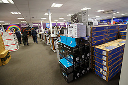 © Licensed to London News Pictures. 26/11/2015. London, UK. Reduced televisions for Black Friday sale left untouched at a Currys PC World store in Tottenham Hale, north London on Friday, 27 November 2015. Photo credit: Tolga Akmen/LNP