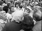 """Fr Niall O'Brien says Thanksgiving Mass.1984..16.07.1984..07.16.1984..16th July 1984..In celebration of his safe homecoming from the Philippines,Fr Niall O'Brien said a thanksgiving mass At Newtownpark Ave,Blackrock,Dublin. Along with two other priests and six lay people,Fr Niall was falsly accused of multiple murders.They became known as """"The Negros Nine"""".After President Reagan visited Ireland,The American government put pressure on the Marcos regime and all charges were dropped and all were fully exonerated....Photograph taken as Fr O'Brien is mobbed by well wishers after the mass in Blackrock...Note; Fr O'Brien, who was born in Dublin in 1939,died in Pisa, Italy in 2004"""