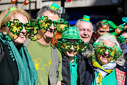 © Licensed to London News Pictures. 17/03/2019. London, UK. People celebrate St Patrick's Day as the parade travels through the streets of central London. Photo credit: Dinendra Haria/LNP