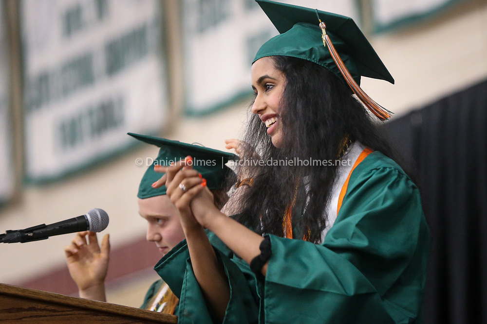 (5/31/19, HOPKINTON, MA) Valedictorian and Salutatorian Jane Stilwell, and Priya Hegde, right deliver their speech   during graduation at Hopkinton High School on Friday. [Daily News and Wicked Local Photo/Dan Holmes]