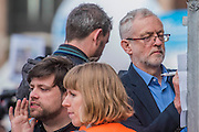 Jeremy Corbyn makes last minute notes for his speech - A march against cuts to and potential privatisation of the NHS starts in Tavistock Square and heads for Parliament Square. The march was organised by the peoples assembly and supported by most major unions and the Labour Party.