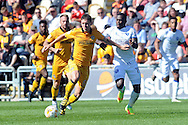 Newport's Mark Randall (l) holds off Mansfield's Mitchell Rose. Skybet EFL league two match, Newport county v Mansfield Town at Rodney Parade in Newport, South Wales on Saturday 6th August 2016.<br /> pic by Carl Robertson, Andrew Orchard sports photography.