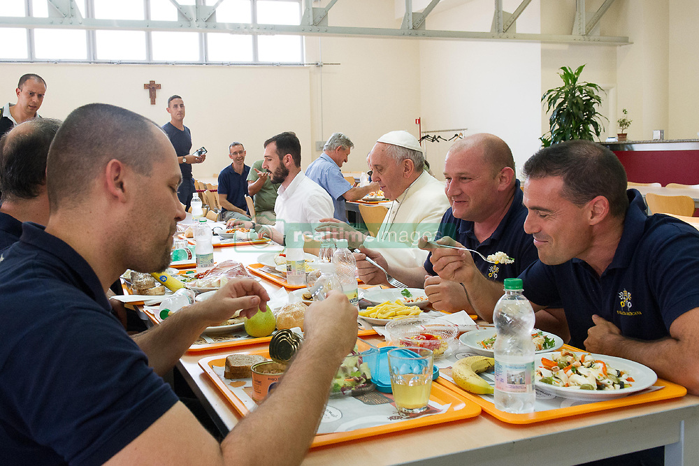 FRANCE OUT - Pope Francis eats with the Vatican's blue-collar workers at their cafeteria at the Vatican on July 25, 2014. The Vatican is the planet's smallest State. Within this tiny political entity, the world's largest and most influential Church's executive powers affect the lives of at least one billion Catholics throughout the world. In fact, the Vatican is the only State in the world subservient to a religion. The pontifical palace, Swiss Guards, in-house newspaper, railroad station and hundreds of employees, executives, manual laborers and craftsmen, are all part of life in the Vatican, to which we have been invited for a special visit. Some 2,000 employees cross over the Santa Anna gate each morning at around 7 am, the gateway guarded both by the Swiss Guards and the vigilenzia (Vatican police force). Not all of them work at the Vatican by vocation, but many admit that a deep personal connection to the Pope has motivated their choice of work. Photo by Eric Vandeville/ABACAPRESS.COM  | 582152_029 Vatican City Vatican Vatican (or Holy See)